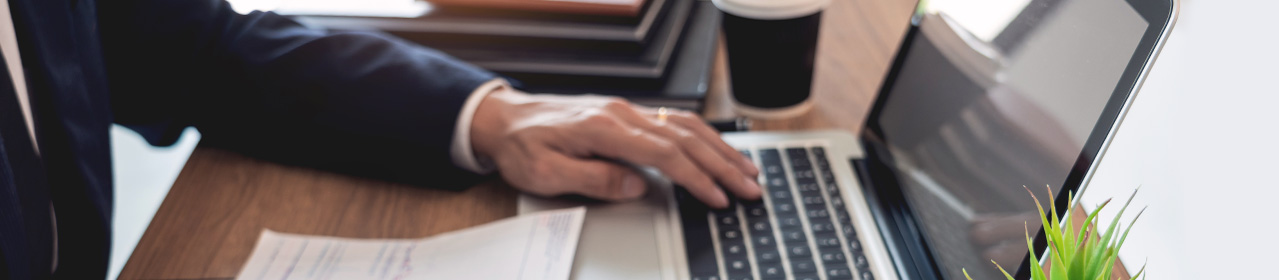 photo of mans hand using laptop