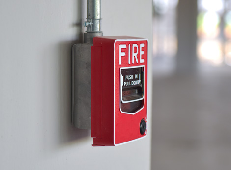 photo of a fire alarm on a white wall